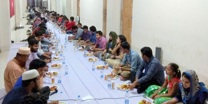 Attendees are having Iftar